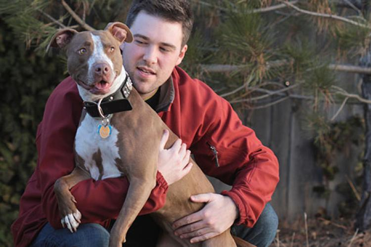 All pitbulls, even this well-behaved pitbull and his person, can be unfairly targeted by dog breed discrimination.