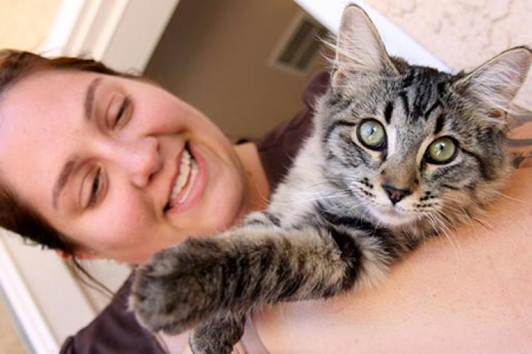 Woman and her cat who has sufferered from fatty liver disease