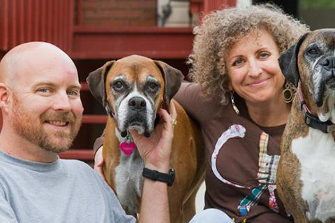 Couple with their two dogs. They run their own small animal welfare organization.