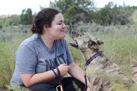 Woman teaching a dog to speak (bark)