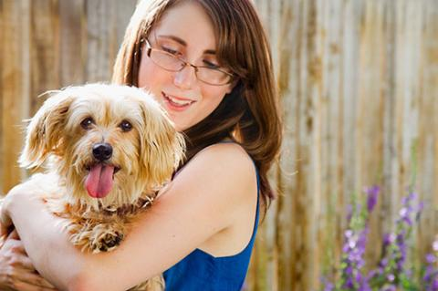 Woman and her rescue dog. Help save pets today by adopting your next pet.