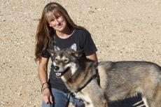 Sherry Woodard with a malamute-type dog
