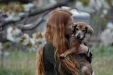 Woman with her beloved dog. The decision about when to euthanize an ailing pet is not easy.